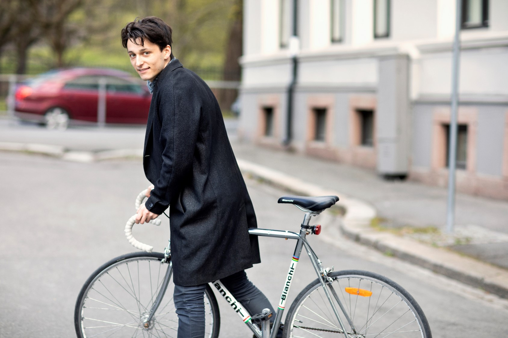 Male student on bicycle outdoors